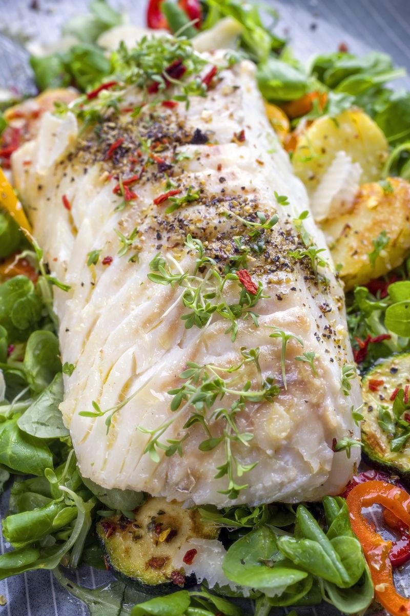 Fried black cod fillet with lettuce salad